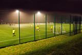 Night football training on an Astroturf facility