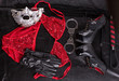 Fetish, stuff for role-playing games and bondage, high heels shoes, leather whip and hand cuffs on a background of black leather