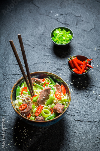 Tasty asian noodle with beef chilli peppers © shaiith