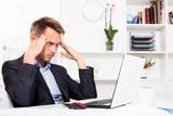 Man sitting at working and having work troubles