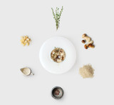 Cooking ingredients for italian risotto with wild mushrooms isolated