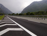 Traffic on Toll Road in the Italian Alps near border France and Mont Blanc