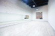 Interior of an empty dance and fitness studio with loft design and big mirrors.