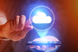 Concept of cloud storage icon flying out a smartphone - technolo