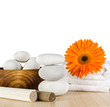 Spa concept / Spa decoration with orange Gerbera daisy, towel and spa stones