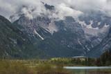 Hiking in the Dolomites. Close to Lago di Dobbiaco, Lago di Landro and Dobbiaco Water treasures. Lake Lago di Dobbiaco is situated at 1259 m in the Val di Landro which links Dobbiaco with Cortina.