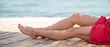Woman's beautiful legs on the beach