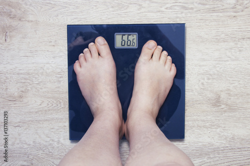 Feet on scales. Excess weight Poster