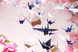 Traditional Japanese origami on strings in the background graphics and sakura