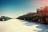 Several tractors lined up in the agricultural sector