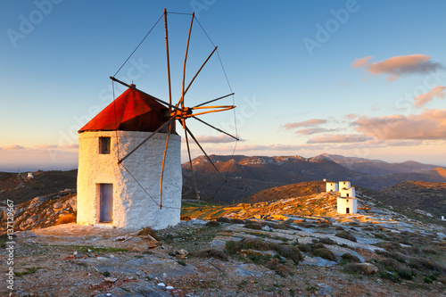 Windmills over  Chora of Amorgos island early in the morning.