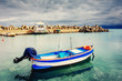 ship at sea under dramatic clouds. Sicily Italy Europe