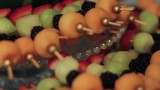 Assorted fruit skewers on a platter