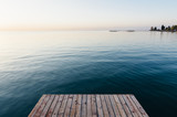 Empty pier on Lake Issyk-Kul in Cholpon-Ata, Kyrgyzstan. Sunrise time