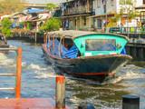 Ferryboat, public motorboat on small channel. Bangkok, Thailand