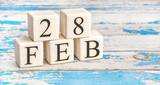 February 28th. Wooden cubes with date of 28 February on old blue wooden background.