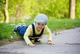 Adorable preschool child skateboarding on the street