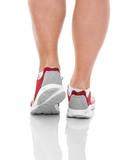 Mens sports legs in sneakers.