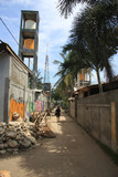 Indonesian man walking down street in Gili Trawangan