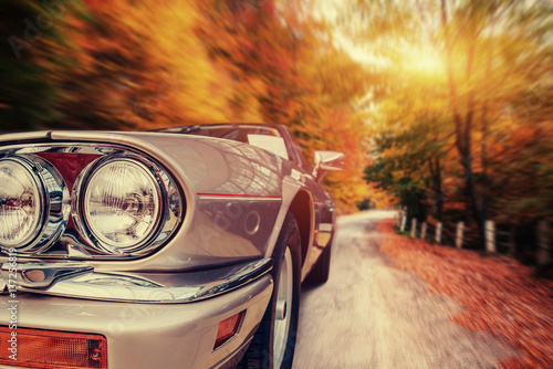 Fantastic asphalt road in the mountains. Classic car