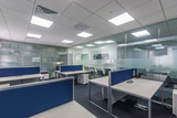 Workplaces in a bright modern open space office - 137261077