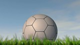 A static shallow depth of focus time lapse over a day of a soccer ball in the grass on a cloudy blue sky background - 3D render
