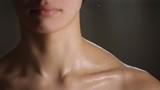 white girl doing massage to her shoulder