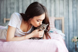 Girl teenager with a domestic cat - 137290001