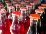 glass bottles with soft drinks background - 137290809