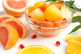 Fruit fresh juicy salad with orange, pineapple, grapefruit and pomegranate breakfast for vitamins on a light background