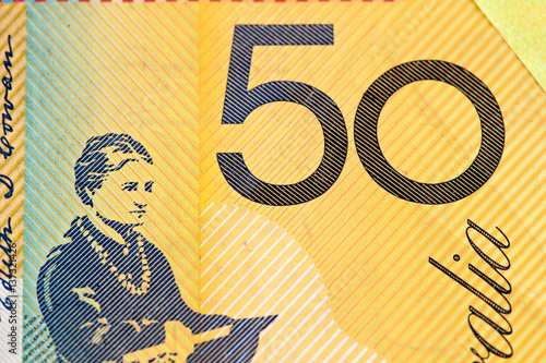 Poster Australian 50 dollar bill fragment closeup showing the number fifty on yellow background