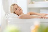 Fototapety Beautiful blond woman relaxing in bathtub