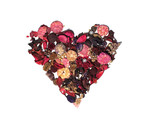 Heart made of dried petals and flowers on a white background.
