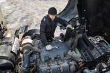 Mechanic serving the truck