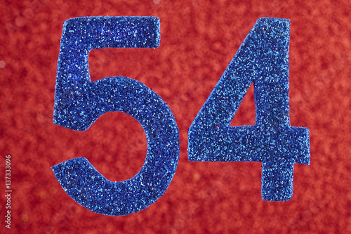 Poster Number fifty-four blue over a red background. Anniversary.
