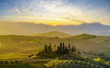 Tuscan autumn landscape in the light of the rising sun