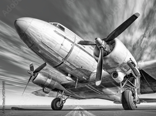 historic airplane on a runway Poster