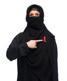 muslim woman in hijab with red awareness ribbon