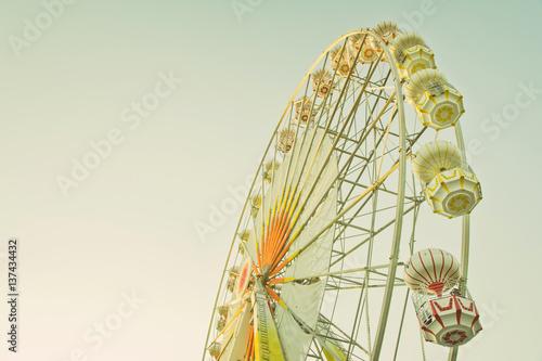 ferris wheel against a blue sky in vintage style