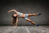 Young beautiful fitness woman posing in studio - 137466890