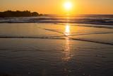 Warm sunset on the sea coast.