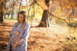 Beautiful pregnant woman outdoors