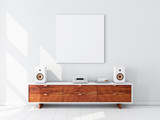 Square white canvas Mockup hanging on the wall, hi fi micro system on bureau,3d rendering