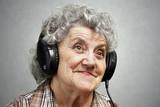 Happy grandmother in headphone