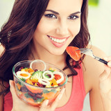 brunette woman with vegetarian vegetable salad