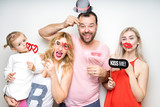 happy smile family dad mom daughter baby sitter strike a pose party photo booth props laugh - 137573605