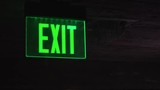 Green emergency exit sign illuminated.