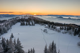 Winter sunrise seen from the snow covered Luban peak, Gorce mountains, Poland