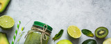 Healthy green food background - smoothie and ingredients. Long banner format