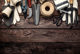 gardening tools on dark wooden background with space for text top view - 137613473